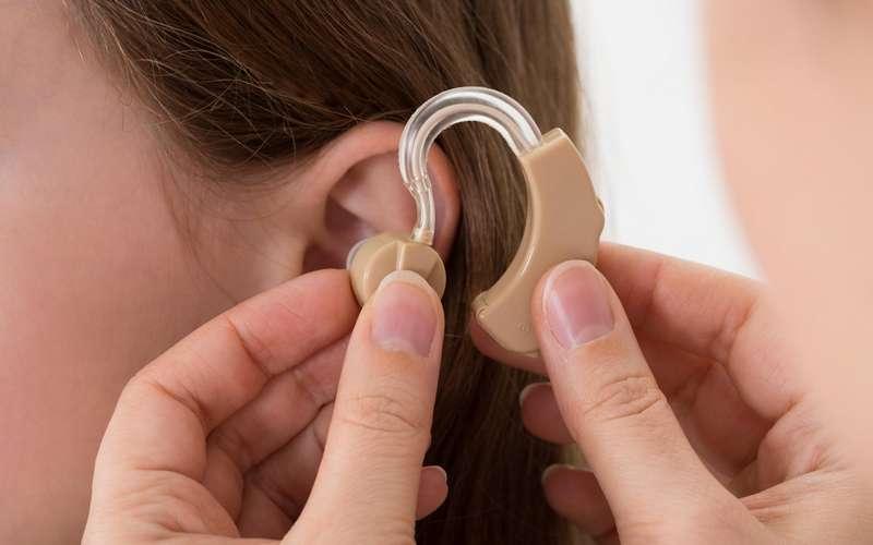 applying hearing aid