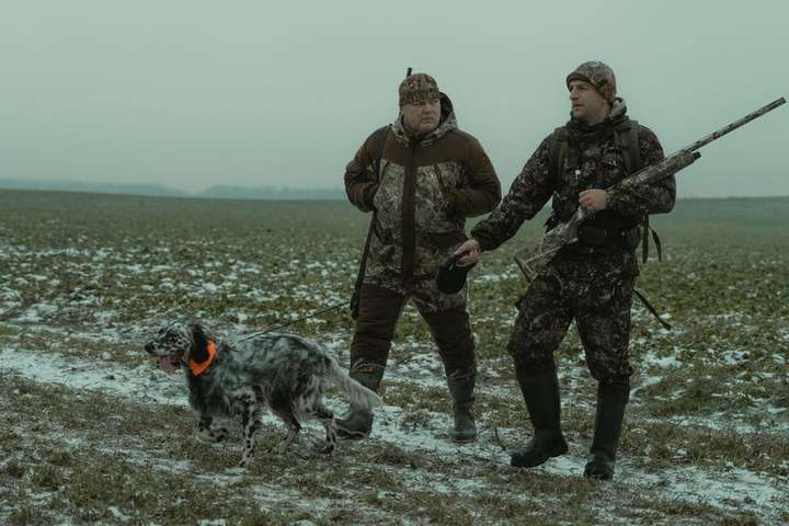 two hunters and the dog