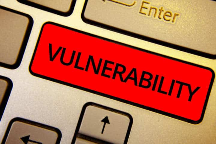 Text sign showing Vulnerability. Conceptual photo Information susceptibility systems bug exploitation attacker Keyboard brown keys yellow laptop idea create computer keypad laptop