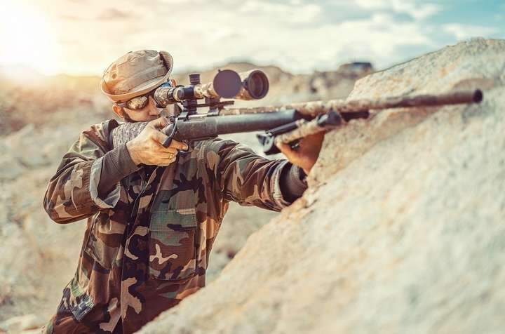 sniper with scope riffle