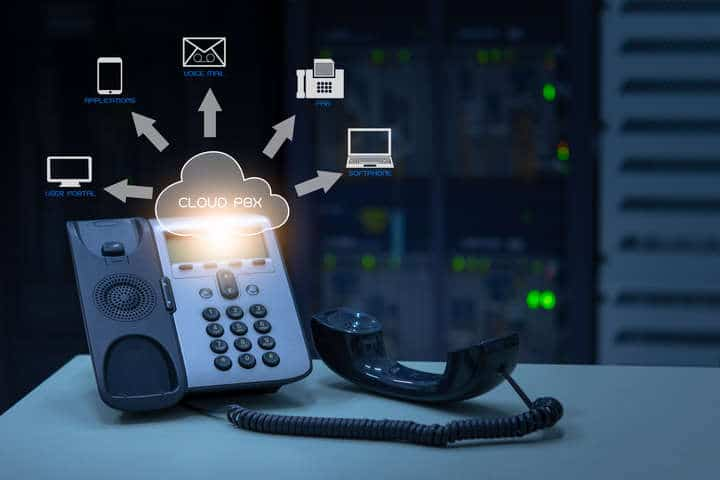 IP Telephony cloud pbx concept, telephone device with illustration icon of voip services and networking data center on background
